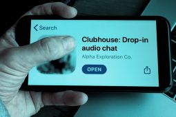 A hand holding a phone and the clubhouse application is open on this phone.